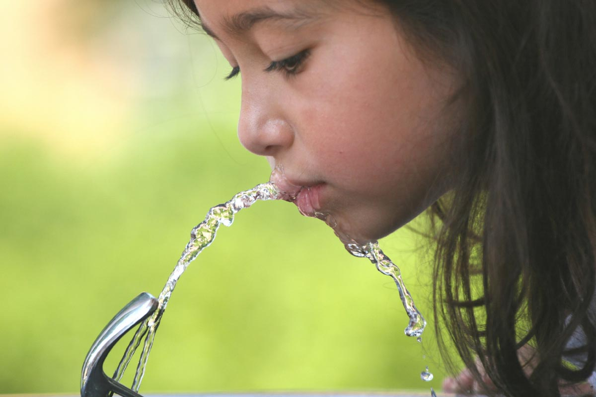Girl-Drinking-Water-Fountain